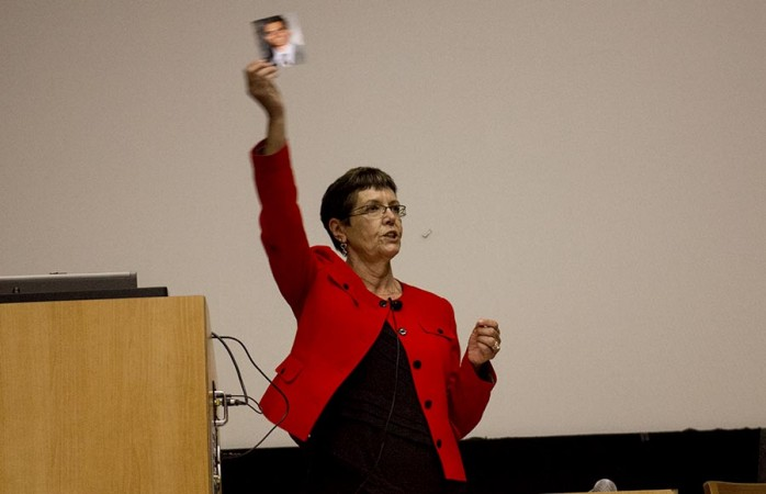 Former San Quentin prison warden Jeanne Woodford, pictured above, debates Contra Costa district attorney Mark A. Peterson about Proposition 34, during a seminar in Wheeler Hall Auditorium.